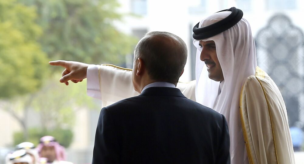 Emir of Qatar Sheikh Tamim bin Hamad Al-Thani, right, points as Turkey's President Recep Tayyip Erdogan looks on during a welcome ceremony in Doha, Qatar, Wednesday, Feb. 15, 2017
