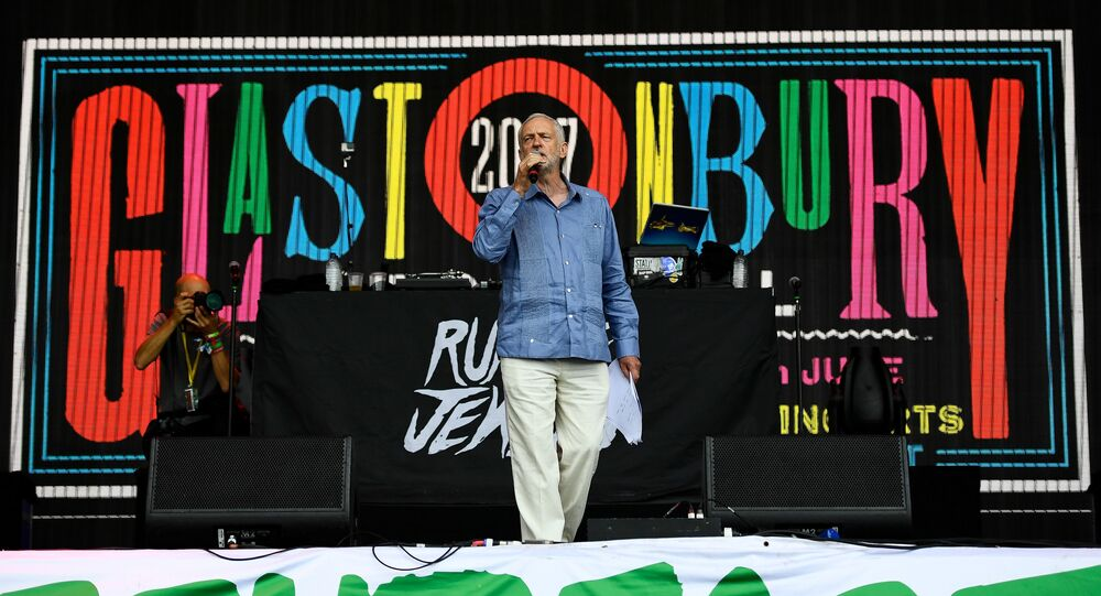 Britain's opposition Labour Party leader Jeremy Corbyn addresses revellers from the Pyramid Stage at Worthy Farm in Somerset during the Glastonbury Festival in Britain, June 24, 2017.