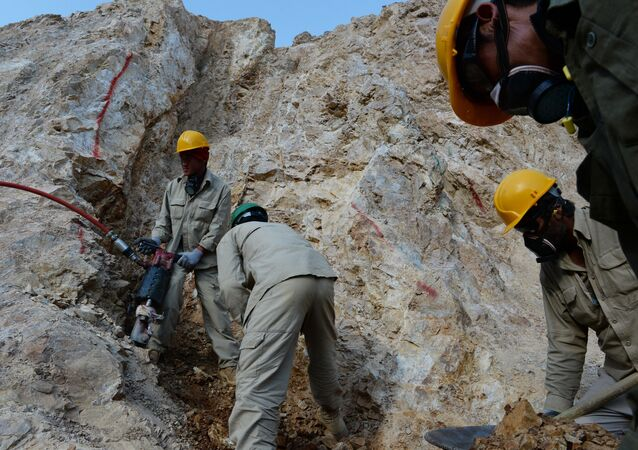 Afghan miners work at a gold mine on a mountainside near the village of Qara Zaghan in Baghlan province (File)