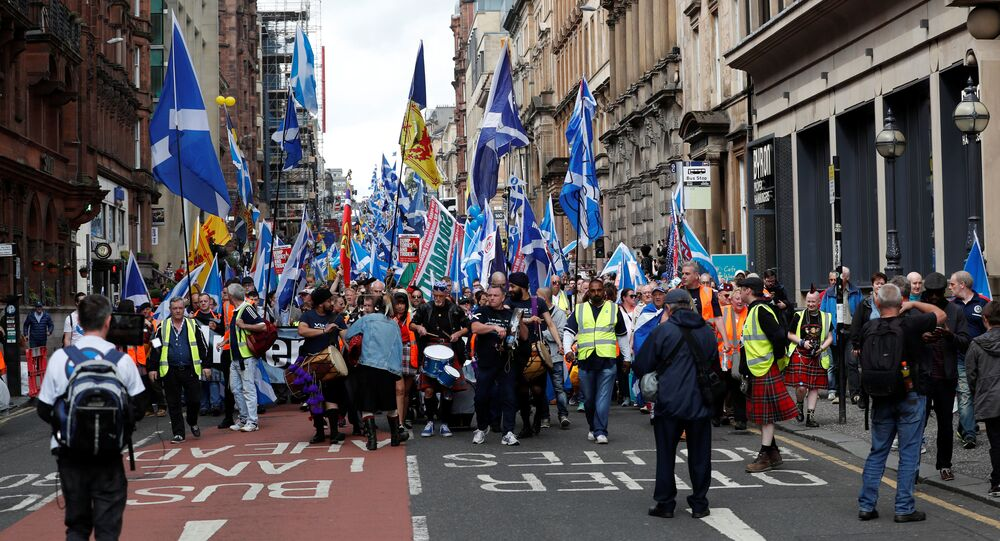 Demonstrators carry Scottish flags at a march in support of Scottish independence, in Glasgow, Scotland, Britain June 3, 2017