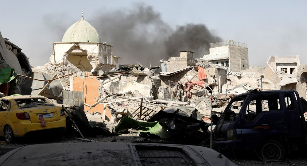 Smoke billows from the ruined Grand al-Nuri Mosque after it was retaken by the Iraqi forces at the Old City in Mosul, Iraq June 29, 2017