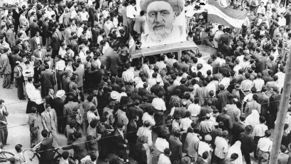 In this Dec. 13, 1951 file photo, crowds of supporters of Prime Minister Mossadegh gather around a huge portrait of Iranian Mullah Kashani, one of the powerful backers of Mossadegh's regime, in Tehran. Once expunged from its official history, documents outlining the U.S.-backed 1953 coup in Iran have been quietly published in June 2017, by the State Department, offering a new glimpse at an operation that ultimately pushed the country toward its 1979 Islamic Revolution and hostility with the West. - Sputnik International