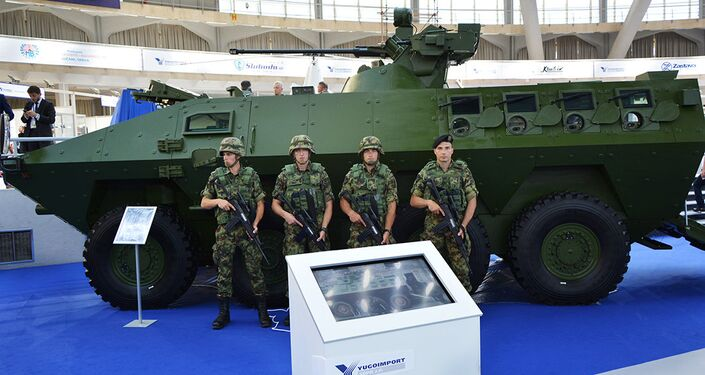 In this photo Serbian soldiers seen near a Serbian military vehicle during the Partner-2017 fair