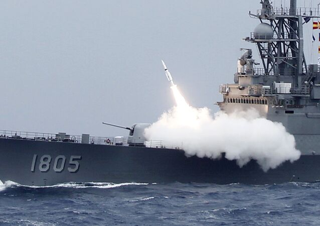 Taiwan's navy launch a surface-to-air SM-2 missile from a Kidd class destroyer during the Hai-Biao (Sea Dart) annual exercises off the northeastern coast of Taiwan, Thursday, Sept. 26, 2013