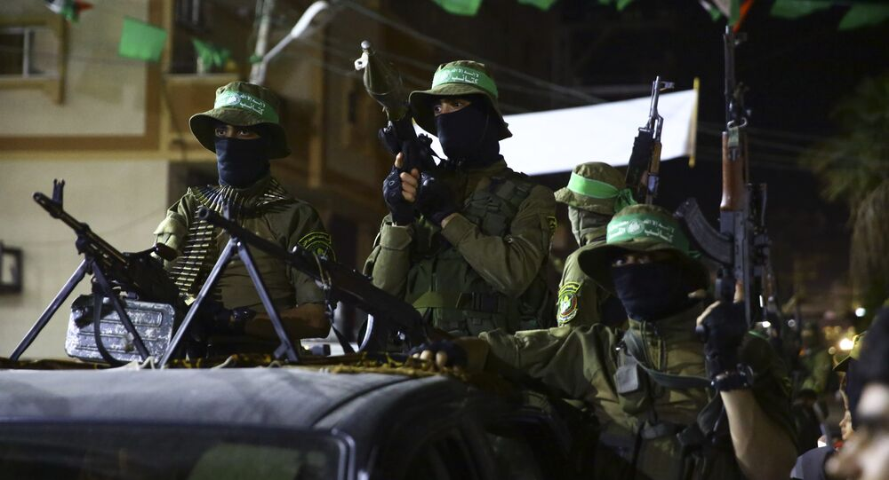 Masked militants from the Izzedine al-Qassam Brigades, a military wing of Hamas, ride vehicles during a rally marking Al-Quds, Jerusalem, Day in Nusseirat refugee camp, in the central Gaza Strip, Friday, June 23, 2017