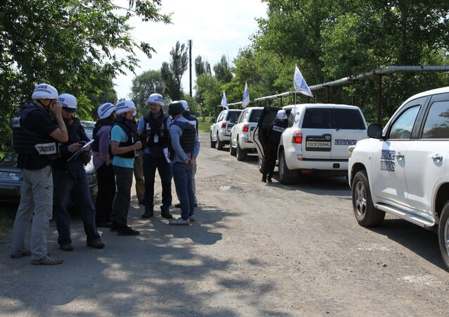OSCE Special Monitoring Mission (SMM) monitors during an inspection of the frontline township of Sakhanka in the self-proclaimed Donetsk People's Republic