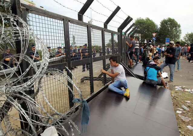 Refugees from the Middle East on the Serbian-Hungarian border. File photo
