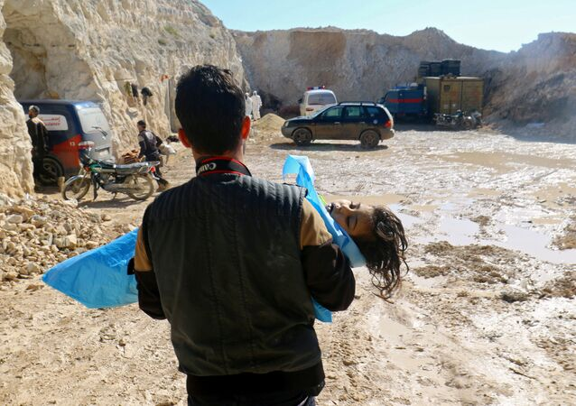 A man carries the body of a dead child, after what rescue workers described as a suspected gas attack in the town of Khan Sheikhoun in rebel-held Idlib, Syria April 4, 2017