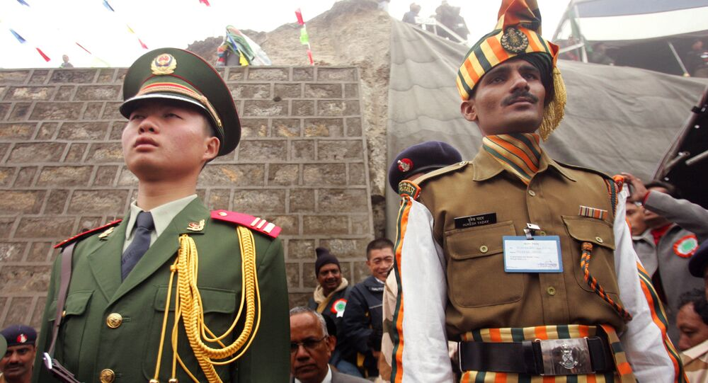 A Chinese soldier, left, and an Indian soldier maintain ceremonial positions marking the international boundary between their countries, respectively, at the opening of the Nathu La Pass in the northeastern Indian state of Sikkim, Thursday, 6 July 2006.