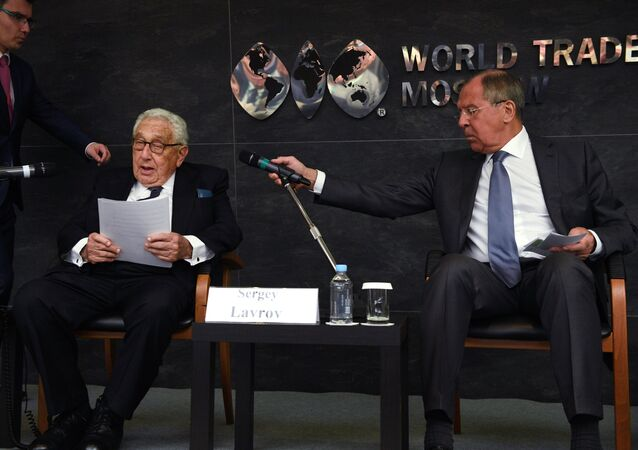 From left, foreground: Former US Secretary of State Henry Kissinger and Foreign Minister Sergei Lavrov at the Primakov Readings international expert forum
