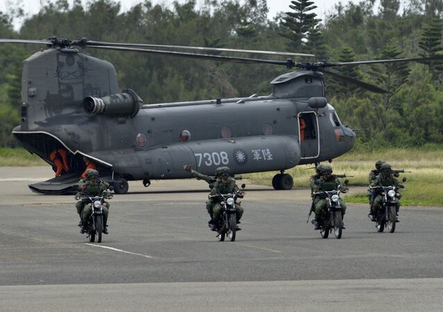 This file photo shows armed Taiwanese soldiers riding on motorcycles next to a US-made CH-47 helicopter during drills on Penghu islands