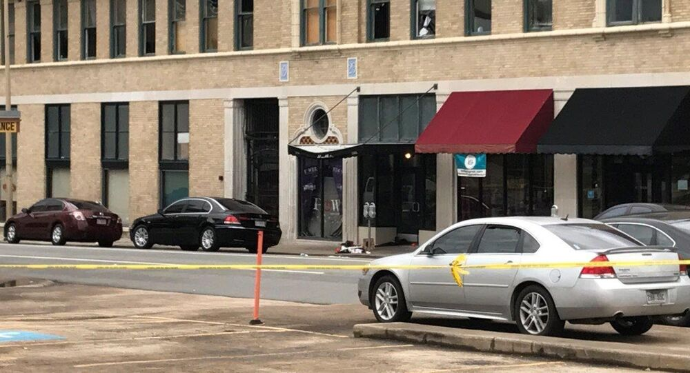 The entrance of an Arkansas nightclub where police are investigating a shooting is cordoned off with police tape Saturday, July 1, 2017, in Little Rock, Ark.