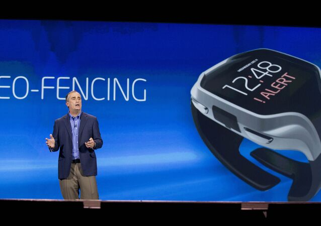 Intel CEO Brian Krzanich talks about geo-fencing in a wearable tracker during a keynote address at the Consumer Electronics Show, Monday, Jan. 6, 2014, in Las Vegas