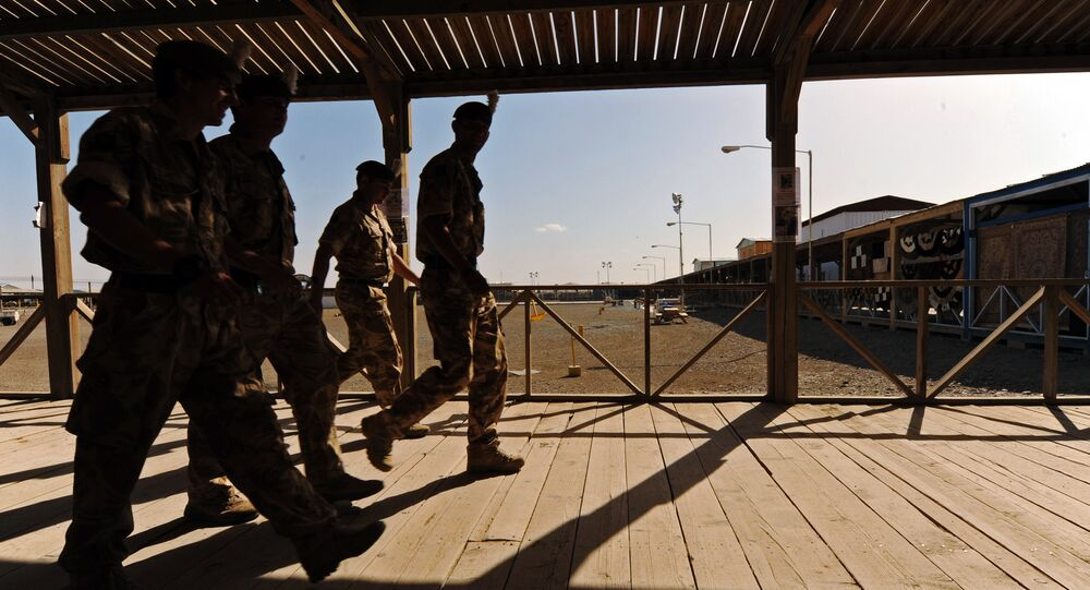 UK soldiers walk at a base in Kandahar on 6 May 2010.