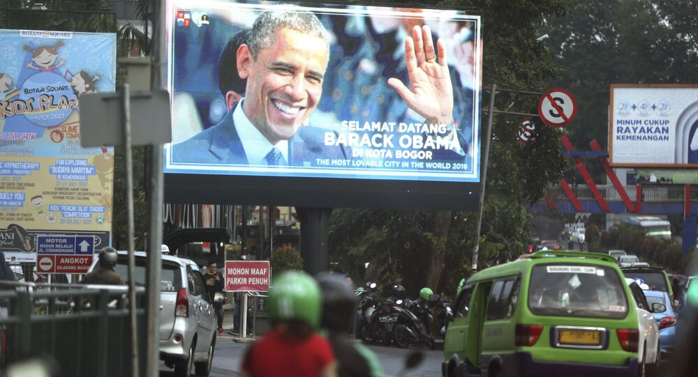 The image of former U.S. President Barack Obama is shown on a large screen at a busy street in Bogor, West Java, Indonesia, Friday, June 30, 2017.