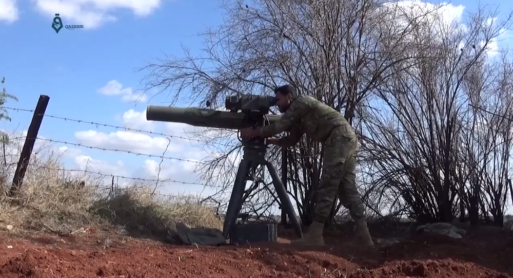 An Army of Glory fighter launches a BGM-71 TOW anti-tank missile at a Syrian government position during the 2017 Hama offensive.