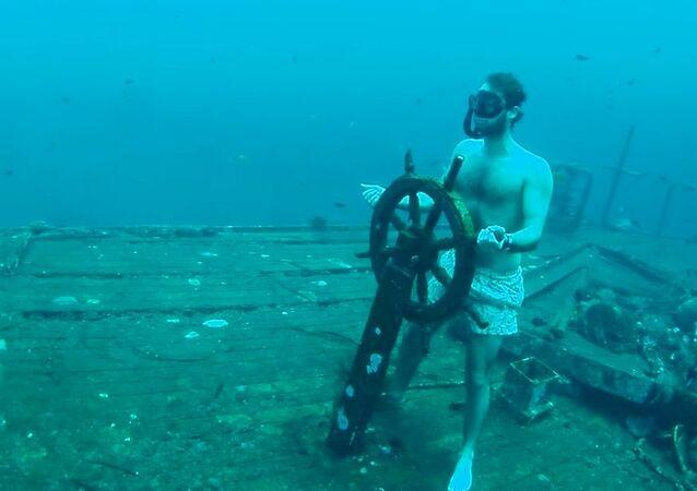 Daredevil Freediver Steers Sunken Shipwreck