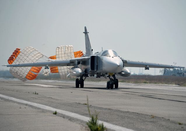 Russia's Su-24 bomber lands at the Hmeymim air base in Latakia, Syria. File photo