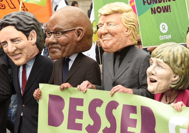 Oxfam's Big Heads depict G20 leaders take part in protests ahead of the upcoming G20 summit in Hamburg, Germany July 2, 2017.