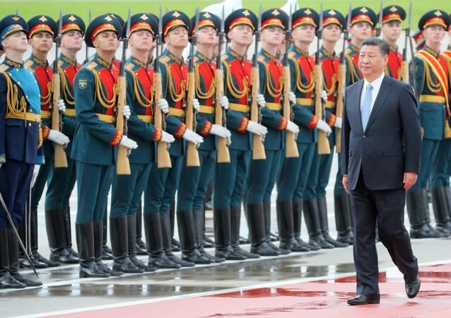 Chinese President Xi Jinping takes part in a welcoming ceremony upon his arrival at Moscow's Vnukovo airport