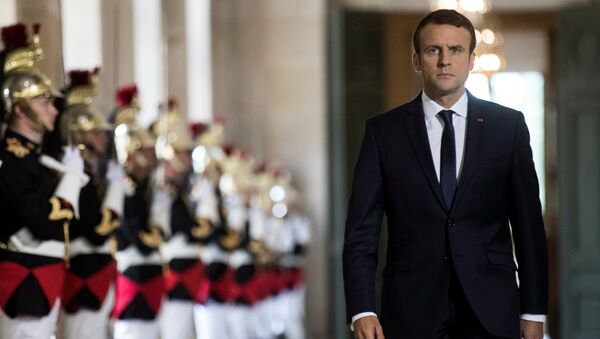French President Emmanuel Macron walks through the Galerie des Bustes (Busts Gallery) to access the Versailles Palace's hemicycle for a special congress gathering both houses of parliament (National Assembly and Senate), near Paris, France, July 3, 2017. - Sputnik International