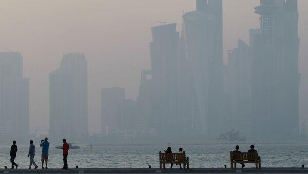 People sit on the corniche in Doha, Qatar, June 15, 2017. - Sputnik International