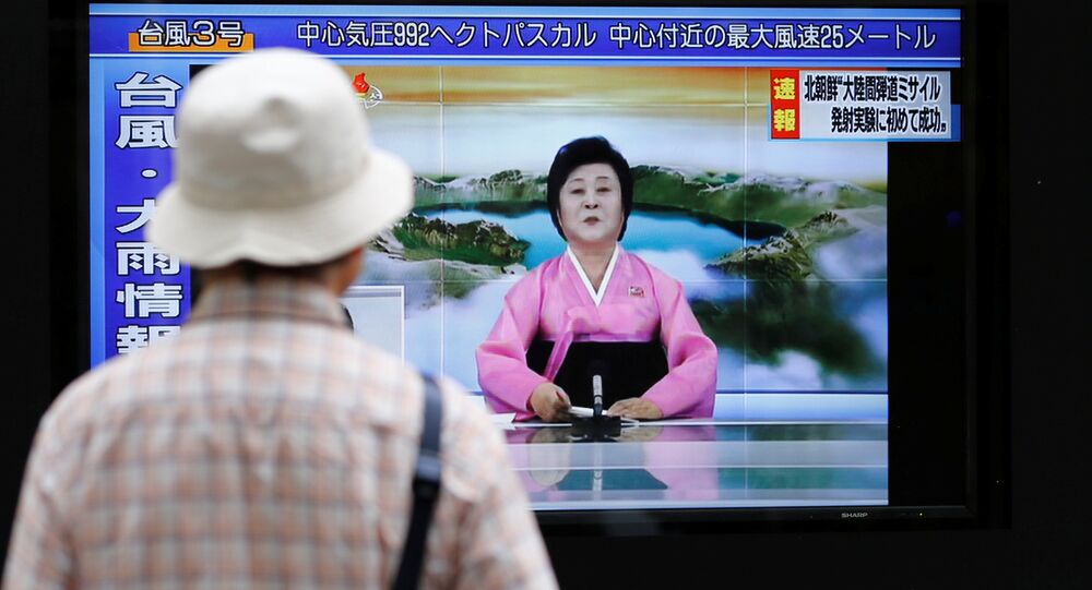 A man looks at a street monitor showing news of North Korea firing a ballistic missile in Tokyo, Japan, July 4, 2017.