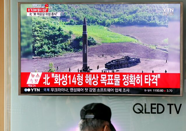A man watches a TV broadcasting still photographs released by North Korea's state-run television KRT of North Korea's Hwasong-14 missile, a new intercontinental ballistic missile, which they said was successfully tested, at a railway station in Seoul, South Korea, July 4, 2017.