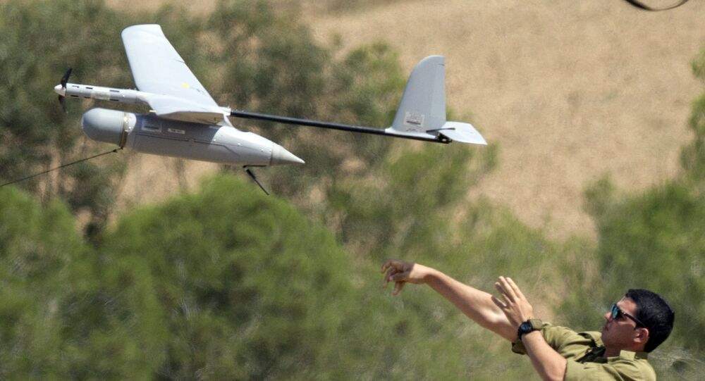 An Israel soldier launches an Israeli army's Skylark I unmanned drone aircraft, which is used for monitoring purposes.