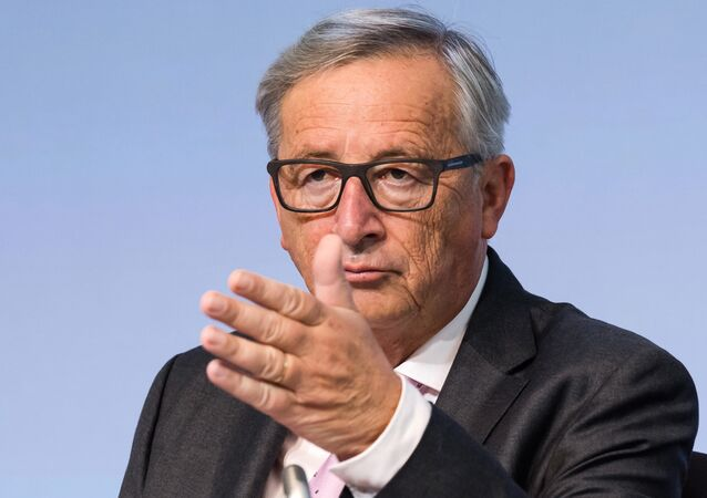 European Commission President Jean-Claude Juncker gestures during a plenary session of European Economic and Social Committee at the EU Charlemagne building in Brussels on Thursday, Sept. 22, 2016.