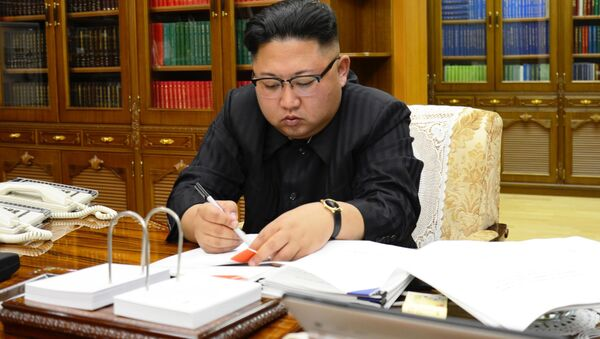 North Korean Leader Kim Jong Un signs the order to carry out the test-fire of inter-continental ballistic rocket Hwasong-14 in this undated photo released by North Korea's Korean Central News Agency (KCNA) in Pyongyang, July, 4 2017. - Sputnik International