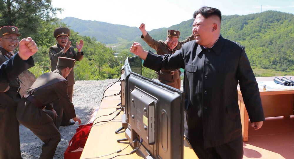 North Korean Leader Kim Jong Un reacts during the test-fire of intercontinental ballistic missile Hwasong-14 in this undated photo released by North Korea's Korean Central News Agency (KCNA) in Pyongyang, July, 4 2017.