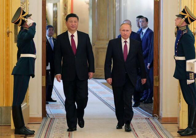 July 4, 2017. From right: Russian President Vladimir Putin meets with People's Republic of China President Xi Jinping in Moscow.