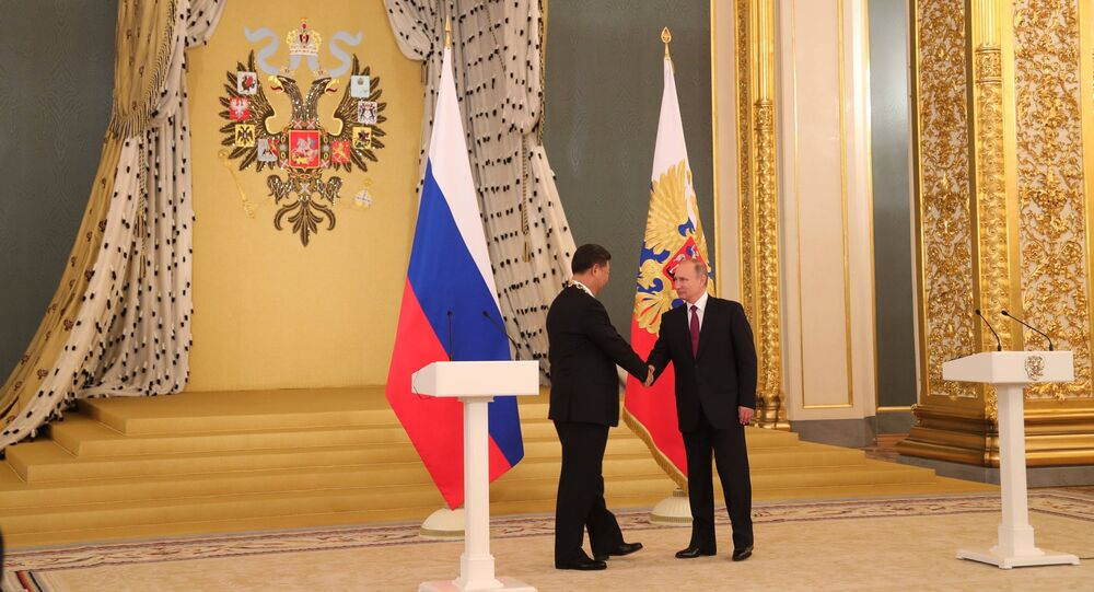 July 4, 2017. From right: Russian President Vladimir Putin meets with People's Republic of China President Xi Jinping who has been awarded the Order of Saint Apostle Andrew the First-Called in Moscow.