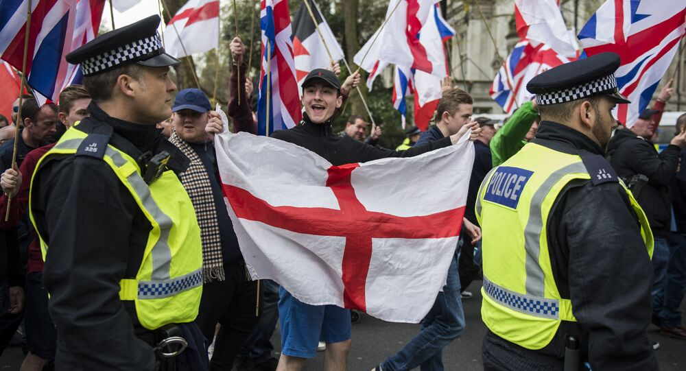 Britain First and EDL (English Defence League) protesters walk along Northumberland Avenue during a demonstration in London, Saturday, April 1, 2017.