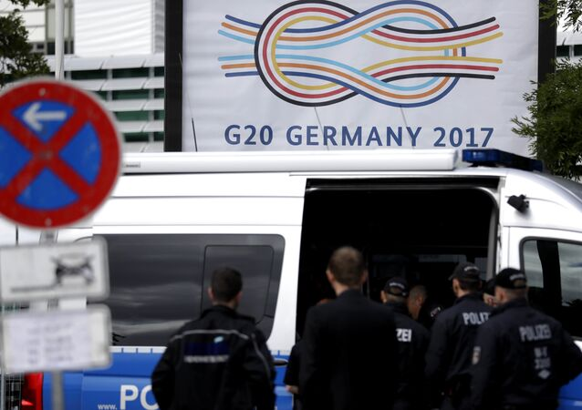 Police officers gather around the fair halls for the upcoming G-20 summit in Hamburg, Germany
