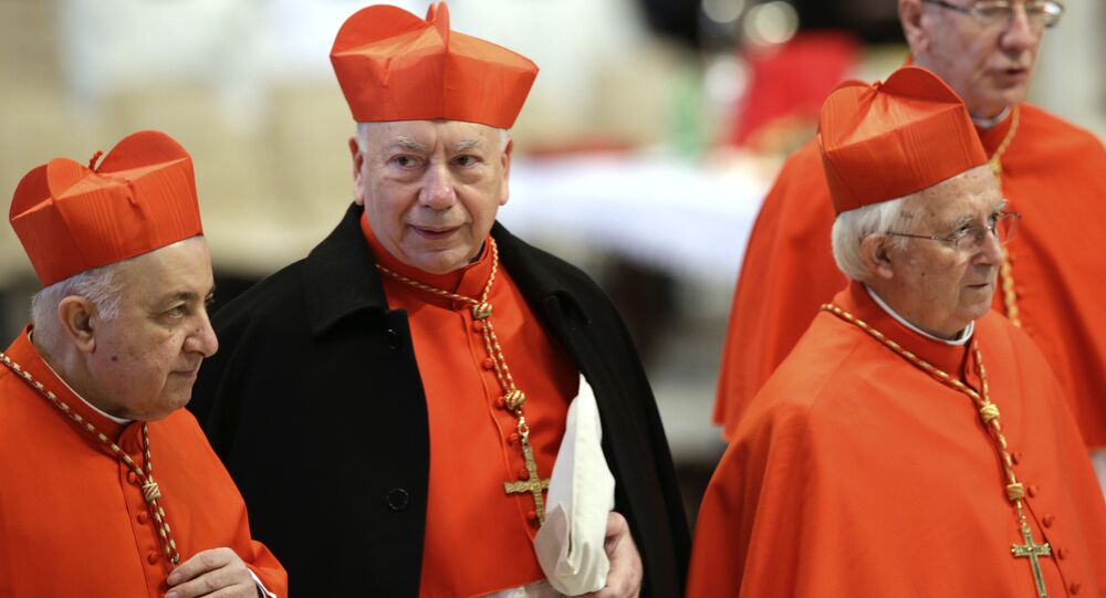 Italian Cardinal Francesco Coccopalmerio, second from left, attends a Mass for the election of a new pope celebrated by Cardinal Angelo Sodano, not pictured, inside St. Peter's Basilica, at the Vatican, Tuesday, March 12, 2013.