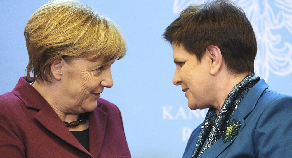 German Chancellor Angela Merkel, left, and Polish Prime Minister Beata Szydlo end a joint press conference after talks in Warsaw, Poland, Tuesday, Feb. 7, 2017.