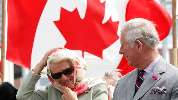 Britain's and Camilla, Duchess of Cornwall, reacts to the wind while sitting next to Prince Charles during an official welcome ceremony at the Nunavut Legislative Assembly in Iqaluit, Nunavut, Canada, June 29, 2017. - Sputnik International