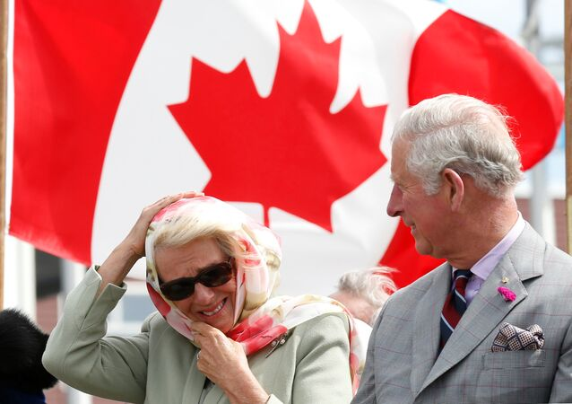 Britain's and Camilla, Duchess of Cornwall, reacts to the wind while sitting next to Prince Charles during an official welcome ceremony at the Nunavut Legislative Assembly in Iqaluit, Nunavut, Canada, June 29, 2017.
