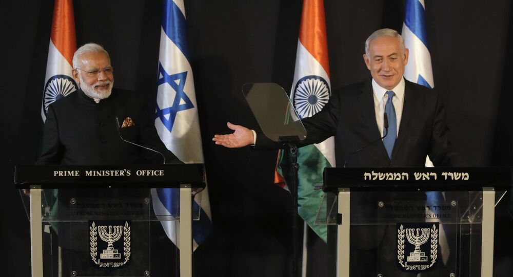 Indian Prime Minister Narendra Modi, left, listens as Israeli Prime Minister Benjamin Netanyahu speaks during their meeting at the King David hotel in Jerusalem,