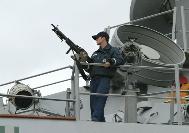 A sailor stands watch onboard the USS LaBoon as the ship sits docked in Philadelphia. (File)