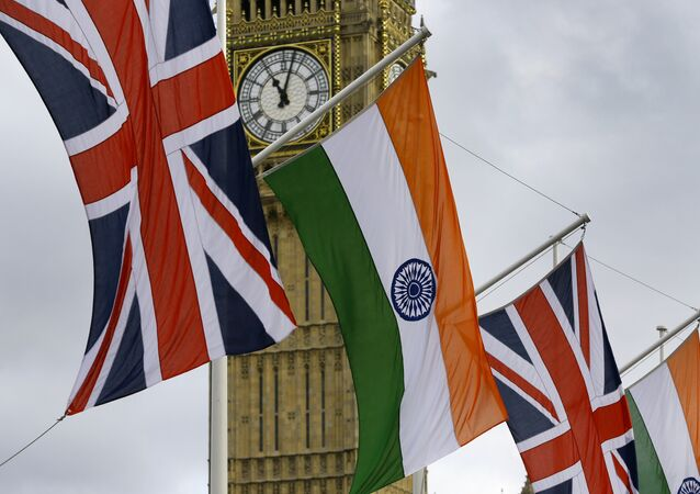 The Union and Indian flags fly in the breeze
