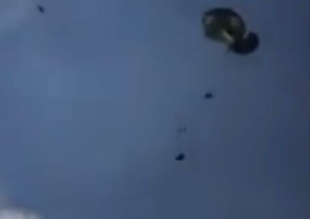 One of three Humvees get's dropped from a transport aircraft, April 2016