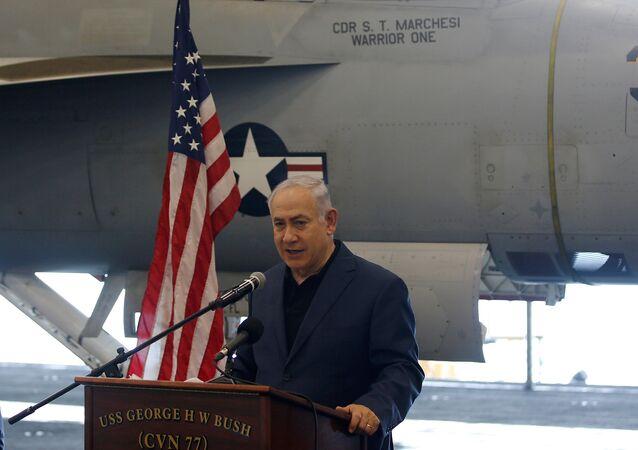 Israeli PM Netanyahu speaks as David Friedman sits next to him during a tour aboard the U.S. aircraft carrier USS George H. W. Bush, as it docks at Haifa port. July 3, 2017.