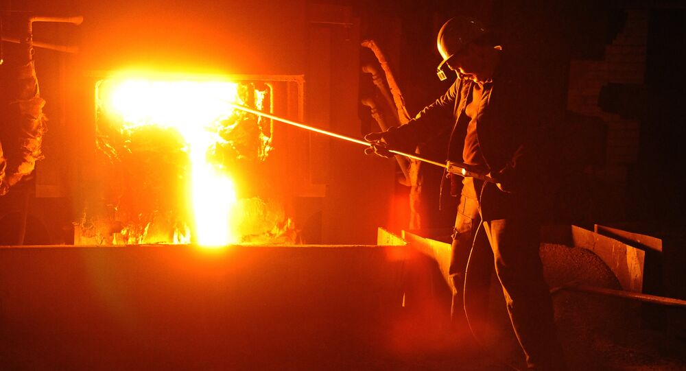 A worker during steel-smelting at BVK LLC, a Russian steelmaking plant.