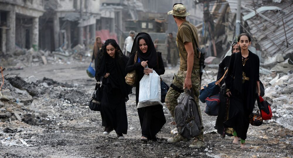 Displaced Iraqi civilians who fled from clashes are seen in the Old City of Mosul, Iraq July 4, 2017