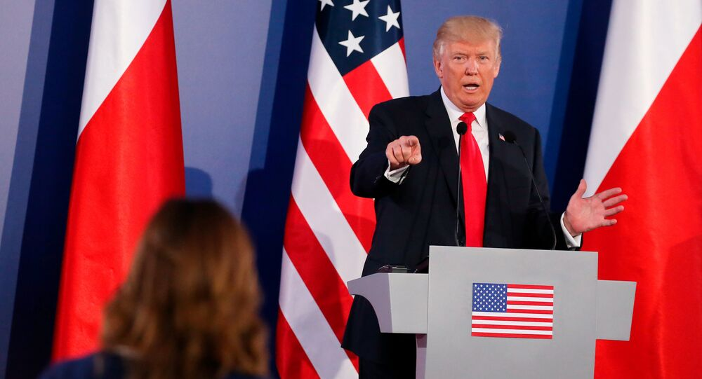 US President Donald Trump gestures during a joint news conference with Polish President Andrzej Duda in Warsaw, Poland July 6, 2017.
