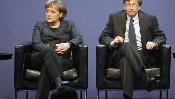 German Chancellor Angela Merkel, left, and the founder of Microsoft, Bill Gates, right, are seen on the podium during the Government Leaders Forum, organized by the software company Microsoft, in Berlin, Germany, on Wednesday, Jan. 23, 2008. - Sputnik International