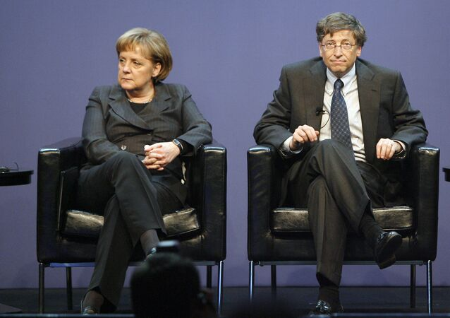 German Chancellor Angela Merkel, left, and the founder of Microsoft, Bill Gates, right, are seen on the podium during the Government Leaders Forum, organized by the software company Microsoft, in Berlin, Germany, on Wednesday, Jan. 23, 2008.